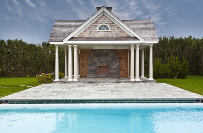 <span>pool house with fireplace</span>