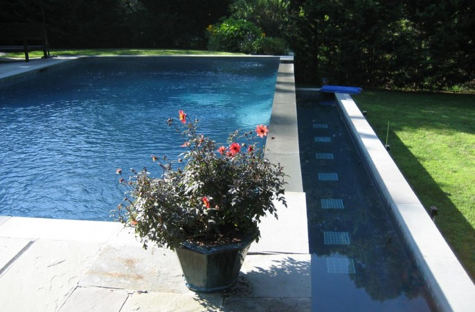 <span>heated gunite infintiy edge pool</span>