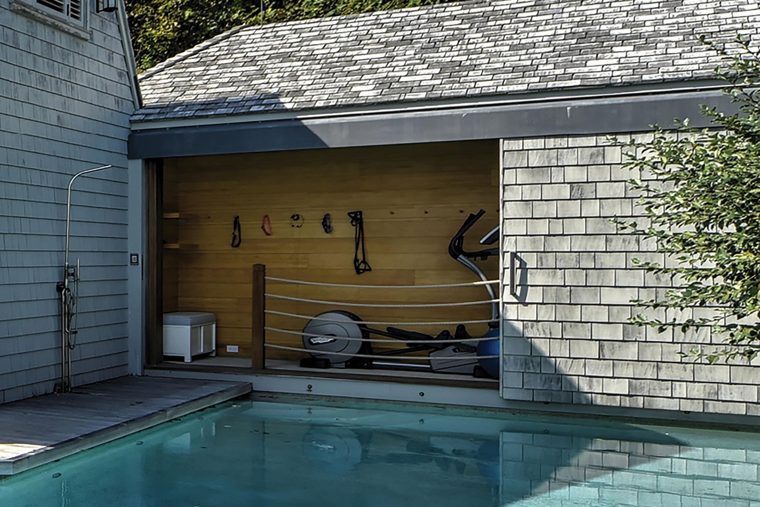 <span>Poolside Gym Cabana & Outdoor Shower</span>