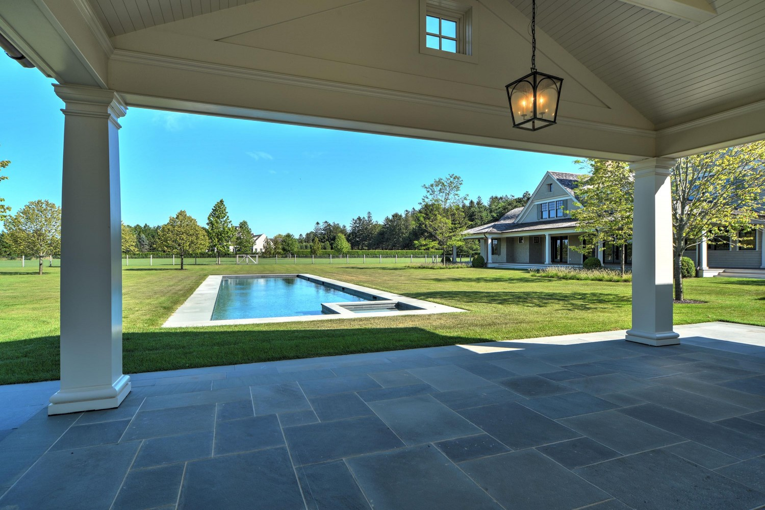 <span>covered patio on pool house</span>